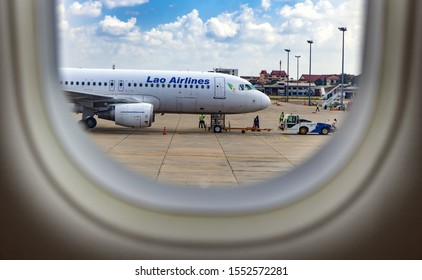 VIENTIANE, LAOS, OCT 28 2016, View trough window of aircraft at Airplane of Lao Airlines standing on The Wattay International Airport, Vientiane, Laos.