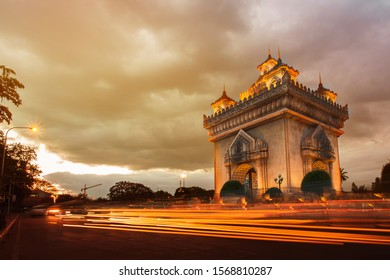 Vientiane Laos, sunset city skyline at Patuxai (Patuxay). Monument, landmark, city, traffic, lighting. Patuxai victory monument architectural landmark of Vientiane Laos.