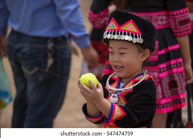 Vientiane Province, December 02 - 2017. Hmong New Year celebration features colorful displays of traditional costumes made from green, red and white silk and ornate silver jewelry at KM 52 village.