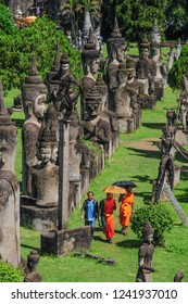 Vientiane/Laos - September, 2015: Visitors in the Buddha Park, one of the most popular attractions in the capital city of Laos.