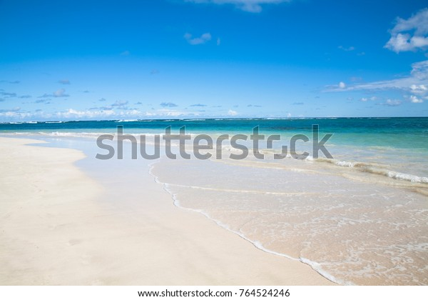 Vieques, Puerto Rico - Gentle waves are rolling up onto the white sands of a tropical beach.