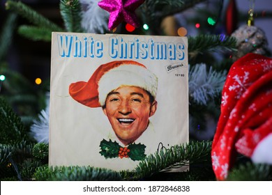 Viersen, Germany - December 9. 2020: Close up of vintage vinyl record cover single with famous Bing Crosby white christmas song in decorated fir tree (focus on cover center)