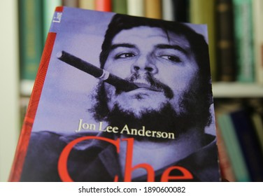 Viersen, Germany - January 2021: Close up of isolated book cover of jon lee anderson che guevara biographie, shelf background (selective focus on center of face)