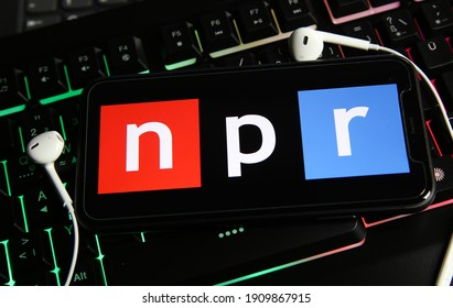 Viersen, Germany - January 9. 2021: Closeup of smartphone screen with logo lettering of independant online radio broadcast service npr on computer keyboard (focus on letter p)