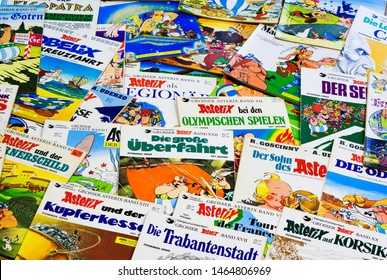 VIERSEN, GERMANY - JULY 29. 2019: Close up of countless issues of german Asterix and Obelix comics