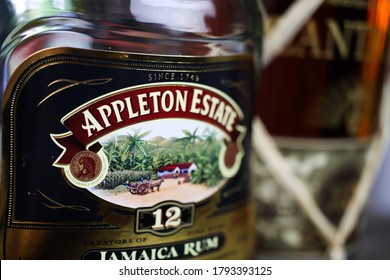 """Viersen, Germany - July 9. 2020: Closeup of isolated bottle label of 12 years old Appleton Estate jamaica rum (focus on first letter """"A"""")"""