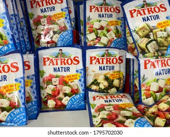 Viersen, Germany - July 9. 2020: View on isolated Patros feta sheep cheese packs in cooling shelf of german supermarket