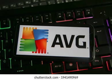 Viersen, Germany - March 1. 2021: Closeup of mobile phone with logo lettering of avg anti virus computer security software on keyboard (focus on letter V left part)