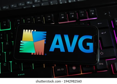 Viersen, Germany - March 1. 2021: Closeup of mobile phone with logo lettering of avg anti virus computer security software on keyboard (focus on center of letter V right part)