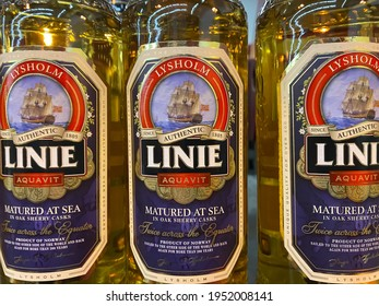 Viersen, Germany - March 1. 2021: Closeup of bottles with lysholm linie aquavit logo lettering in shelf of german supermarket (focus on center of central bottle)