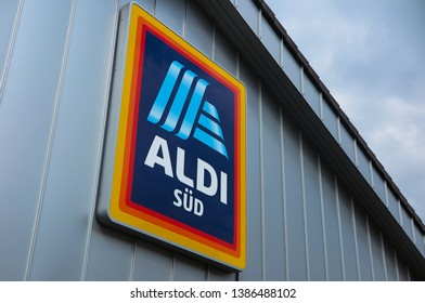 VIERSEN, GERMANY - MARCH 27. 2019: View in isolated ALDI logo under the roof of grey metal wall