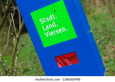 VIERSEN, GERMANY - MARCH 27. 2019: Blue box with red plastic bags to dispose of dogs poo