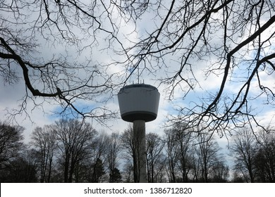 VIERSEN (Dülken), GERMANY - MARCH 27. 2019: View on 55 meter high water tower through bare branches. Tower function as reservoir for 2000 cubic meter water.