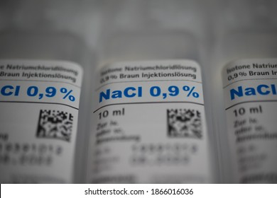 Viersen, Germany - May 9. 2020: Macro close up of isolated 10 ml nacl sodium chloride 0,9 % infusion solution ampules (selective focus on 0 in center)