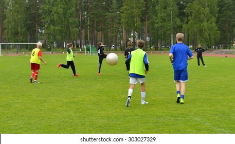 VIERUMAKI, FINLAND - JULY 17,2015:Vierumaki is leisure centre in Finland. It has stadium and football field where teenagers play sports. On the photo they play giant ball on edge of field