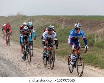 Viesly, France - April 14, 2019: The Slovak cyclist Peter Sagan of Bora-Hansgrohe Team riding in the peloton on the cobblestone road from Briastre to Viesly during Paris Roubaix 2019.