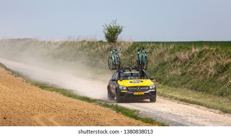 Viesly, France - April 14, 2019: The technical car of  Team Jumbo-Visma is driving on the cobblestone road from Briastre to Viesly during Paris Roubaix 2019.