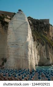 Vieste, Apulia, Italy, August 2018. Beach of Pizzomunno rock, at Vieste, Apulia region , South Italy