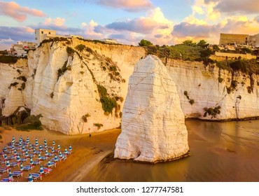 Vieste - Gargano - Apulia - Italy - The Pizzomunno skerry during low tide sunset .