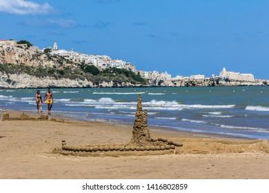 Vieste, Italy - 08 27 2018: Walking on Vieste's beach, fantastic view