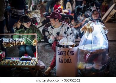 Vietnam 2016 Jan 8,Woman hawker sold food  in Da lad night-market ,Dalad,Vietnam.
