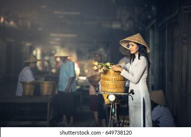 VIETNAM Beautiful women in Ao Dai Vietnam Traditional dress In market