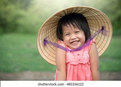 Vietnam concept. Child Vietnam Smiling with Vietnam hat style. Kid vietnamese happy and smile.