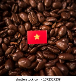a Vietnam flag placed over roasted coffee beans