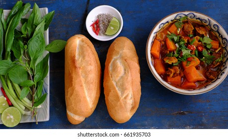 Vietnam food, bread with stewed beef, a popular meal at morning, eat attach parsley, basil, lemon pepper and salt make so delicious taste