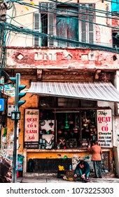 VIETNAM, HANOI - JANUARY 17, 2017: The city's capital street, an old store in a residential building near the road.