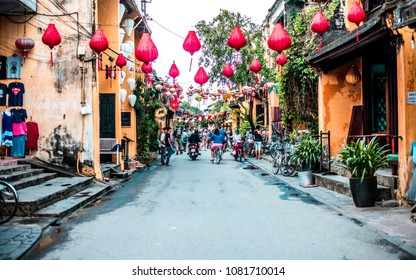 VIETNAM, HANOI - JANUARY 17, 2017: The alley of the old tourist town of Hoi An with red lanterns hanging between houses.