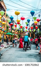 VIETNAM, HANOI - JANUARY 21, 2017: Bright Asian paper lanterns on the streets of the old city of Hanoi, people are walking along the street, a tourist place.