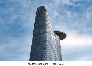 Vietnam, Ho Chi Minh City - January 2, 2017 : Bitexco Financial Tower, an iconic symbol of the development of HCMC, with clear blue sky. This tower consists of offices, retail space and shopping mall.