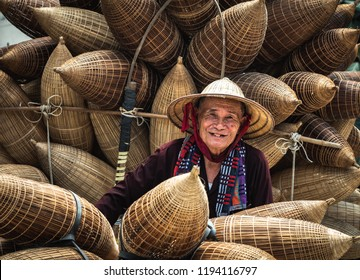 VIETNAM, July 16, 2018 Old Vietnamese craftsman making the traditional bamboo fish trap or weave at the old traditional house in Thu sy trade village, Hung Yen, Vietnam, traditional
