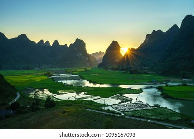 Vietnam landscape with rice field, river, mountain and low clouds in early morning in Trung Khanh, Cao Bang, Vietnam