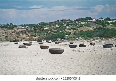Vietnam, Mui Ne, the fishing canoe on the sand coast.