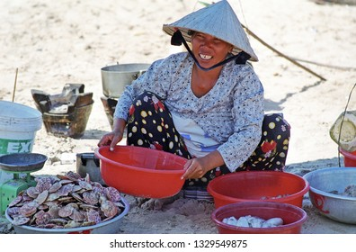 VIETNAM, MUI NE – JANUARY 15, 2001: lady selling fish on the beach. The place is very relaxing.
