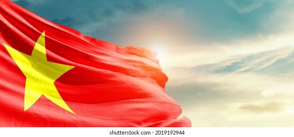 Vietnam national flag waving in beautiful sky.