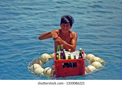 VIETNAM, NHA TRANG – SEPTEMBER 2, 2002: guy preparing drinks for a tourist group in the sea. Very interesting and attractive.