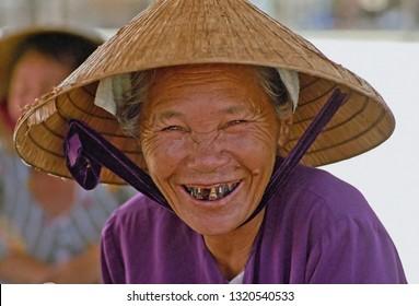 VIETNAM, PHAN THIET – JANUARY 15, 2001: Vietnamese lady face. Very representative of the Vietnamese woman population.