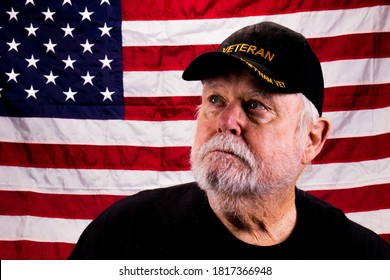 Vietnam Vet With Rough Beard Looking Up With American Flag Backg
