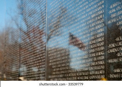 Vietnam Veterans Memorial and reflection of an American Flag