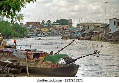 VIETNAM, VINH LONG – MAY 20, 2001: typical village along the Mekong river. The place is very alive.