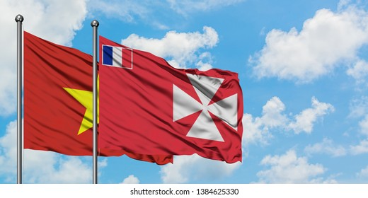 Vietnam and Wallis And Futuna flag waving in the wind against white cloudy blue sky together. Diplomacy concept, international relations.