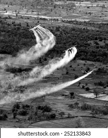 VIETNAM WAR, Crop duster airplanes spray Vietnamese countryside with napalm. photo dated 09/21/66.