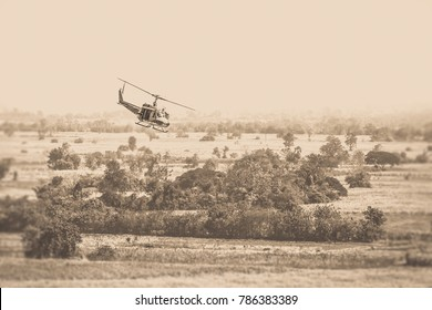 Vietnam War 'style' image helicopters flying low over the jungle in vintage.