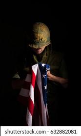 Vietnam War US Marine Holding Stars and Stripes Flag