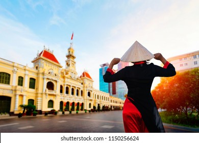 Vietnam woman wearing Ao Dai culture traditional at Ho chi minh city hall in Vietnam.