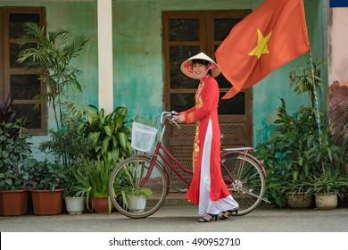 Vietnam,Beautiful woman in Ao Dai vietnam traditional dress