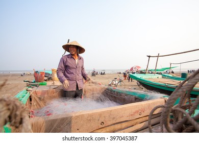 Vietnames fishermen are seen reparing the fish nets on the beach of Centre Vietnam on Feb 20, 2016